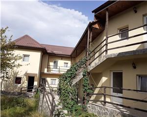 Pensiune P+E 15 camere +Corp de casa, living si 2 camere- BRAN